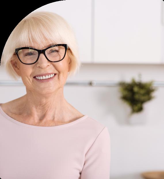 A woman smiles after getting dental restoration at pretoria bridge dental
