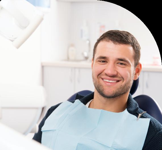 A smiling patient awaits dental work