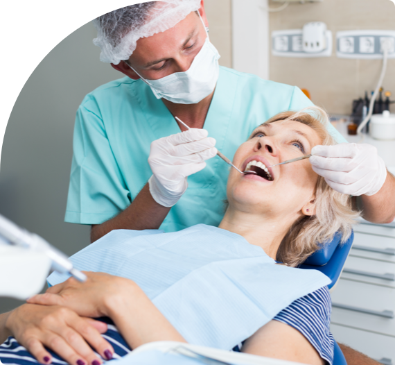 An oral hygienist at Preotira Bridge Dental cleans the teeth of a patient