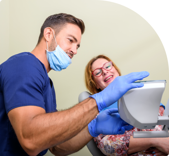 A periodontist consults with a patient