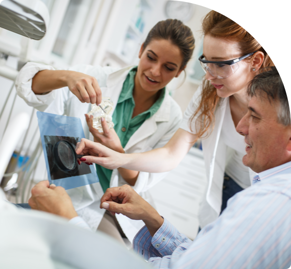 Dentists examine xrays together