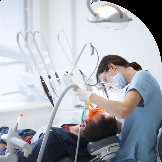 A dentist at Pretoria Bridge Dental performs dental restoration on a patient