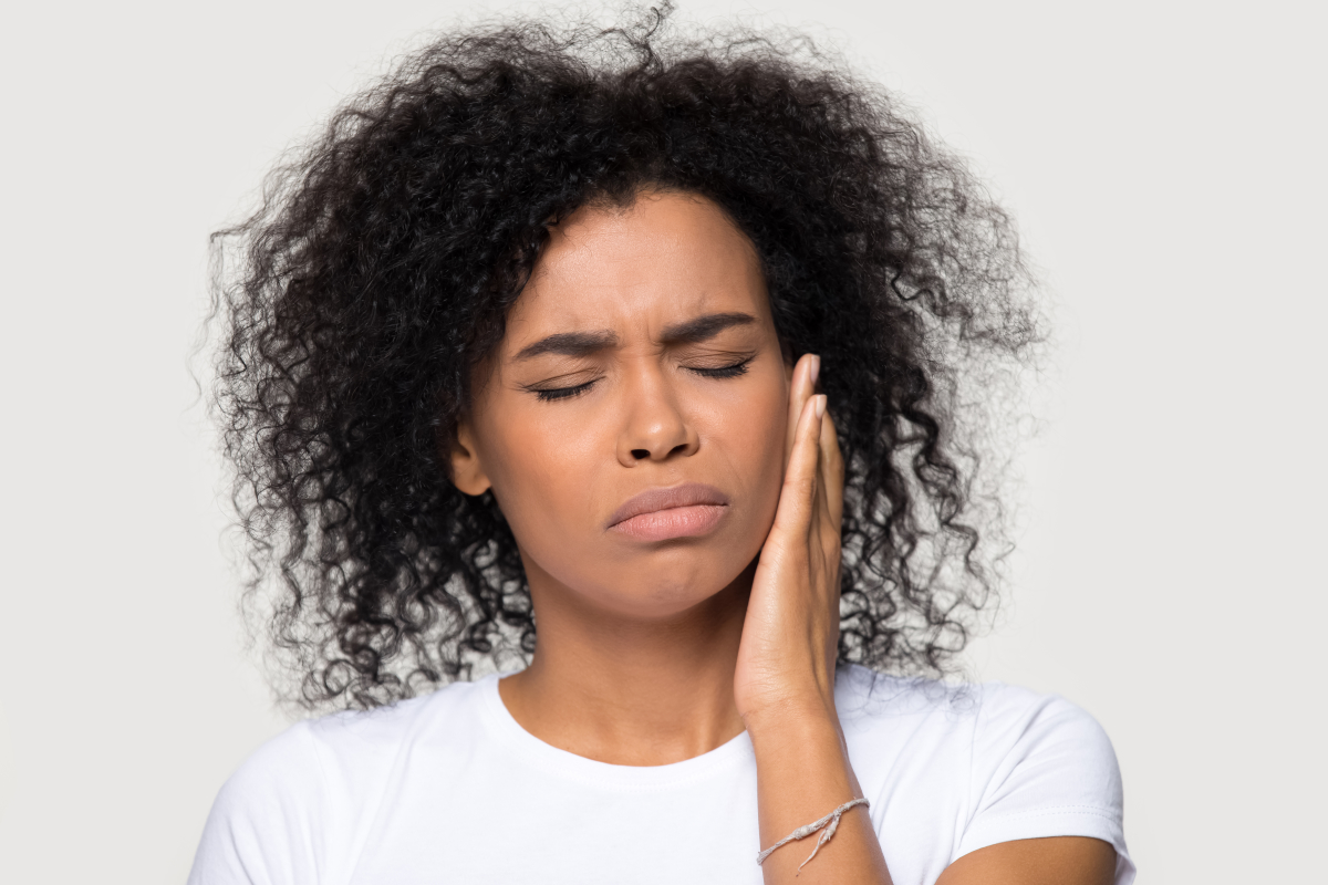 woman experiencing jaw pain from bruxism